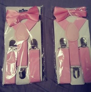 Two pairs of new pink boys suspenders